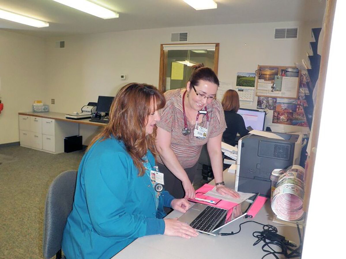 Receptionists on computer