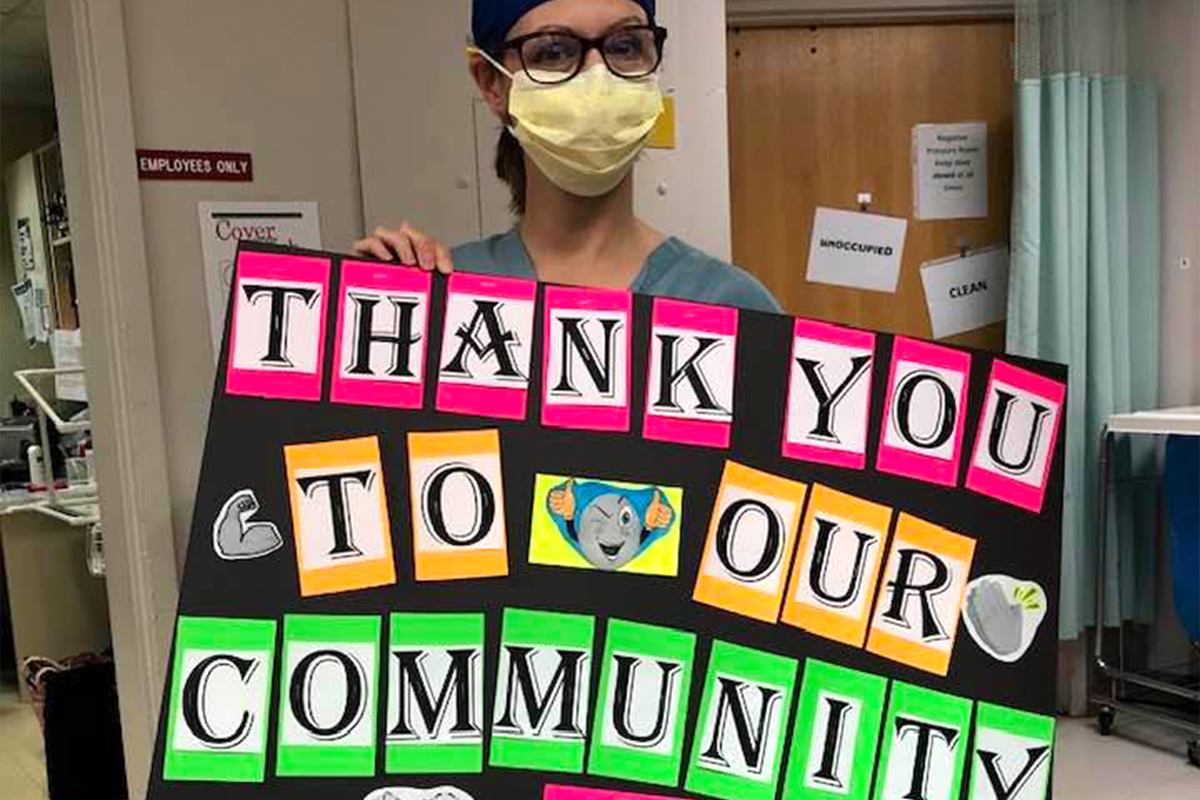 nurse with thank you sign