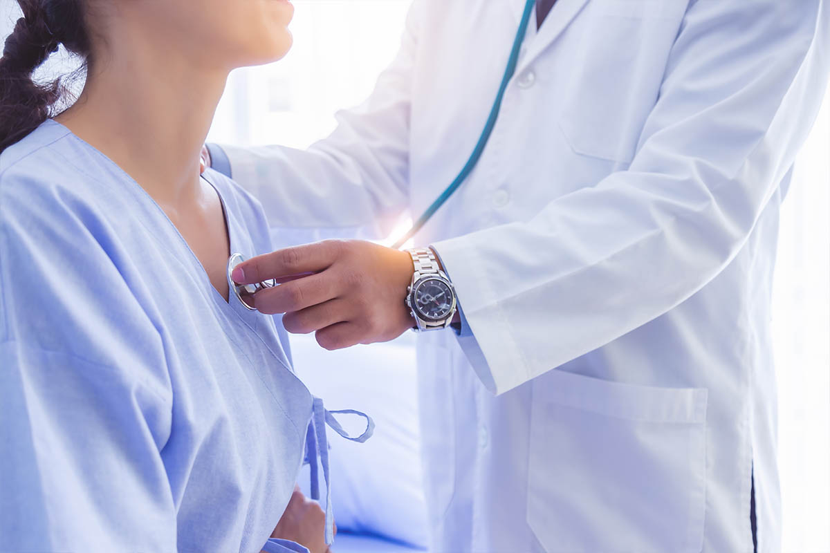 Doctor use stethoscope, checking up heart beat