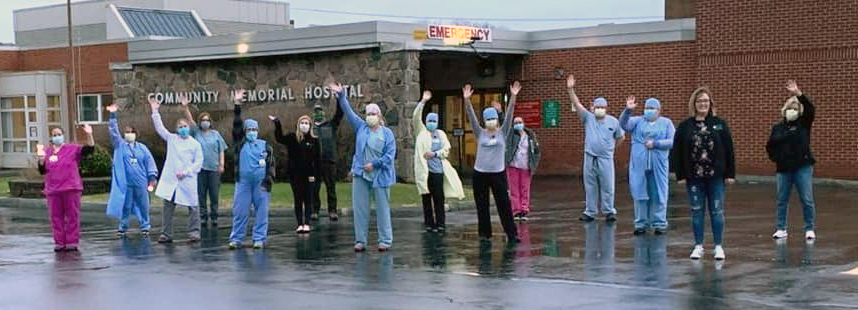 Healthcare providers in front of hospital